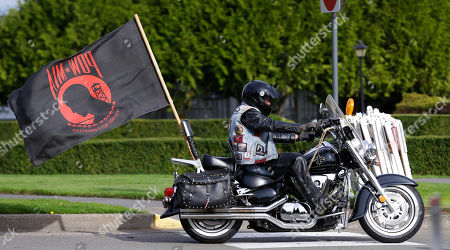 Stock Photo of Robby Robertson Robby Robertson, a member of Rolling Thunder, a POW/MIA remembrance organization, flies a large POW/MIA flag from his motorcycle as he takes part in a group ride prior to a ceremony, in Olympia, Wash. The event honored people who have been prisoners of war and those who are still missing in action. The Olympia event was one of many held nationally. Robertson served in the Army during the Vietnam War