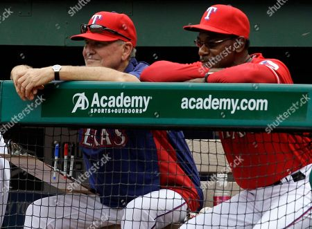 Mike Maddux, Jackie Moore, Ron Washington Texas Rangers bench coach Jackie Moore, left, and manager Ron Washington, right, watch from the during a baseball game against the Kansas City Royals in Arlington, Texas. The Rangers said, that they will not renew the contracts of Moore, who has been in professional baseball 56 years and at Washington's side through two World Series, or first base coach Dave Anderson