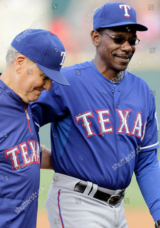 Stock Photo of Ron Washington, Jackie Moore Texas Rangers bench coach Jackie Moore, left, and manager Ron Washington, right, walk across the field during an exhibition baseball game against the Round Rock Express in Round Rock, Texas. The Rangers said, that they will not renew the contracts of Moore, who has been in professional baseball 56 years and at Washington's side through two World Series, or first base coach Dave Anderson