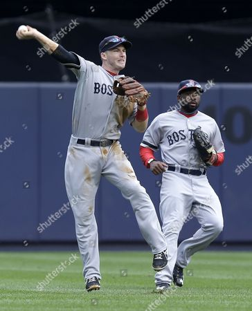 Jackie Bradley Jr., Stephen Drew While Boston Red Sox left fielder Jackie Bradley Jr., right, looks, shortstop Stephen Drew, left, tries but fails to get an out at second base after fielding a single hit by New York Yankees' Vernon Wells during the fifth inning of the baseball game at Yankee Stadium in New York