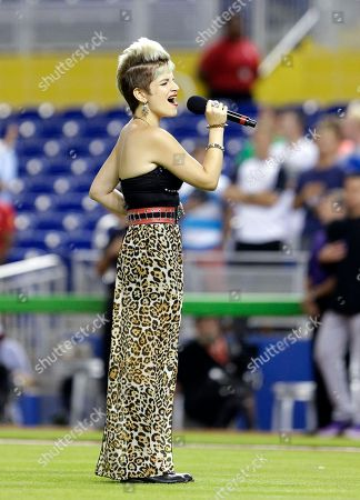 """Michaela Paige Michaela Paige, a finalist on the television show, """"The Voice,"""" sings the National Anthem before the start of a baseball game between the Miami Marlins and the Colorado Rockies, in Miami"""