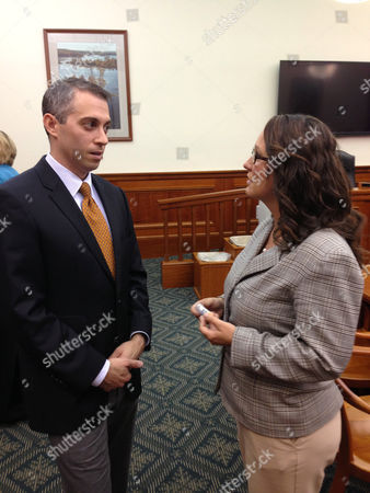 Michigan State Rep. Lisa Posthumus Lyons, R-Alto, right, talking with Dr. Matthew Greenhawt in Lansing, Mich. Lyons is chairwoman of the House Education Committee and plans hearings this week on the state's new color-coded grading system for public schools. Lyons says the system is confusing and says a traditional A to F grading system might be easier to understand