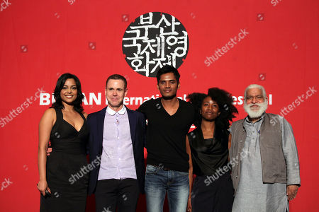"""Stock Image of Shahana Goswami, David Urrutia, Devesh Ranjan, Nanette Nelms, Suresh Jindal Producers and actors of Busan International Film Festival's opening movie """"Vara: A Blessing,"""" from left, Indian actress Shahana Goswami, American producer David Urrutia, Indian actor Devesh Ranjan, American producer Nanette Nelms and Indian executive producer Suresh Jindal pose for photographers at a press conference at Busan Cinema Center in Busan, south of Seoul, South Korea, . """"Vara: A Blessing"""" is the third feature film by Bhutanese lama and filmmaker Khyentse Norbu"""