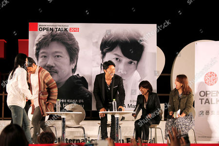 Japanese director Hirokazu Koreeda, second from left, and actor Masaharu Fukuyama, center, leave the stage after an open talk during Busan International Film Festival at BIFF Village on Haeundae beach in Busan, south of Seoul, South Korea