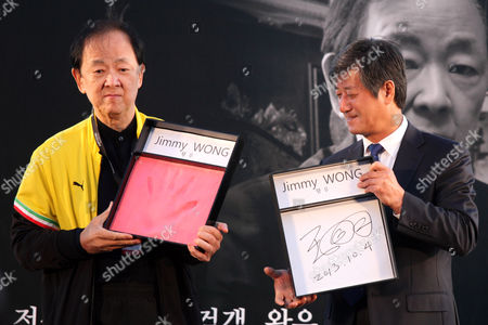 Jimmy Wong Yu, Lee Yong-Kwan Chinese actor Jimmy Wong Yu, left, and Busan International Film Festival Director Lee Yong-Kwan show Wong's hand print and autograph in a hand printing ceremony during a festival event at BIFF Village Stage on Haeundae Beach in Busan, south of Seoul, South Korea