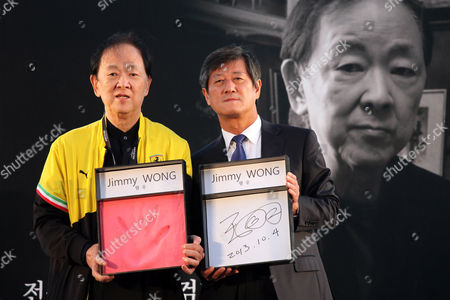 Jimmy Wong Yu, Lee Yong-Kwan Chinese actor Jimmy Wong Yu, left, and The Busan International Film Festival director Lee Yong-Kwan show Wong's hand print and autograph in a hand printing ceremony during BIFF at BIFF Village Stage on Haeundae Beach in Busan, south of Seoul, South Korea
