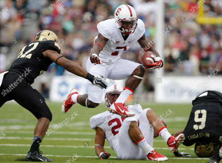 Ty Montgomery, Julian Holloway Stanford wide receiver Ty Montgomery (7) runs the ball against Army linebacker Julian Holloway (42) during the second half of an NCAA college football game, in West Point, N.Y. Stanford won, 34-20