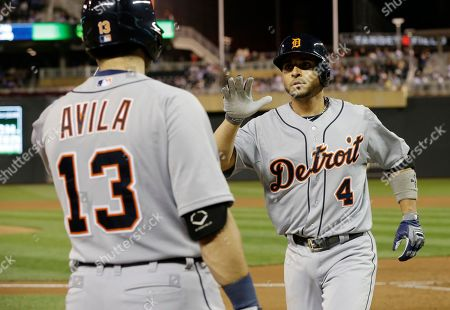 Omar Infante, Alex Avila Detroit Tigers' Omar Infante, right, is congraulated by Alex Avila after his solo home runoff Minnesota Twins pitcher Scott Diamond in the fourth inning of a baseball game, in Minneapolis. AP Photo/Jim Mone