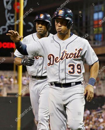 Ramon Santiago, Austin Jackson Detroit Tigers' Ramon Santiago, right, is followed by Austin Jackson, left, as they score on Jackson's two-run home run off Minnesota Twins pitcher Scott Diamond in the fourth inning of a baseball game, in Minneapolis