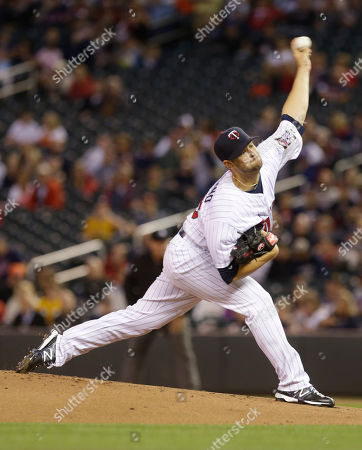 Scott Diamond Minnesota Twins pitcher Scott Diamond throws against the Detroit Tigers in the first inning of a baseball game, in Minneapolis
