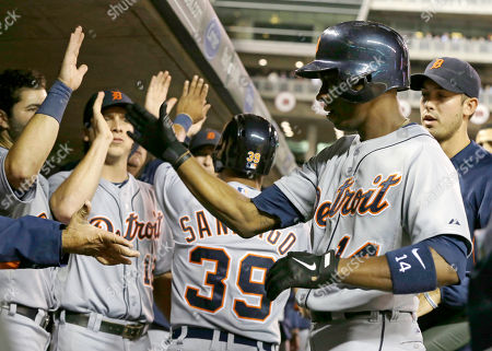 Austin Jackson Detroit Tigers' Austin Jackson, right, is greeted in the dugout after his two-run home run off Minnesota Twins pitcher Scott Diamond in the fourth inning of a baseball game, in Minneapolis