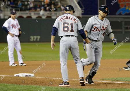 Omar Infante, Tom Brookens Detroit Tigers' Omar Infante, is congratulated by third base coach Tom Brookens after his solo home run off Minnesota Twins pitcher Scott Diamond in the fourth inning of a baseball game, in Minneapolis. AP Photo/Jim Mone