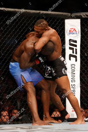 John Howard, Uriah Hall John Howard sinks in a choke against Uriah Hall during their UFC on Fox Sports 1 mixed martial arts bout in Boston, Saturday, August 17,2013. Howard won via decison