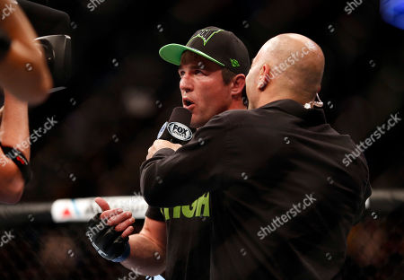 Joe Rogan, Chael Sonnen Chael Sonnen is interviewed by Joe Rogan after defeating Mauricio Rua in their UFC on Fox Sports 1 mixed martial arts light heavyweight bout in Boston, Saturday, August 17,2013. Sonnen won via first round tapout via guillotine choke
