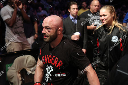 Manny Gamburyan, Ronda Rousey Manny Gamburyan leaves the ring, followed by Ronda Rousey after beating Cole Miller during their UFC on Fox Sports 1 mixed martial arts bout in Boston, Saturday, August 17,2013. Gamburyan won via decison