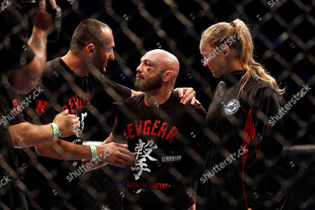 Manny Gamburyan, Ronda Rousey Manny Gamburyan celebrates with a cornerman and Ronda Rousey, right, after beating Cole Miller during their UFC on Fox Sports 1 mixed martial arts bout in Boston, Saturday, August 17,2013. Gamburyan won via decison