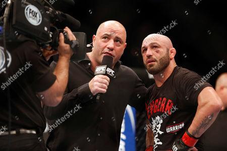 Manny Gamburyan, Joe Rogan Manny Gamburyan is interviewed by Joe Rogan after defeating Cole Miller in their UFC on Fox Sports 1 mixed martial arts bout in Boston, Saturday, August 17,2013. Gamburyan won via decison