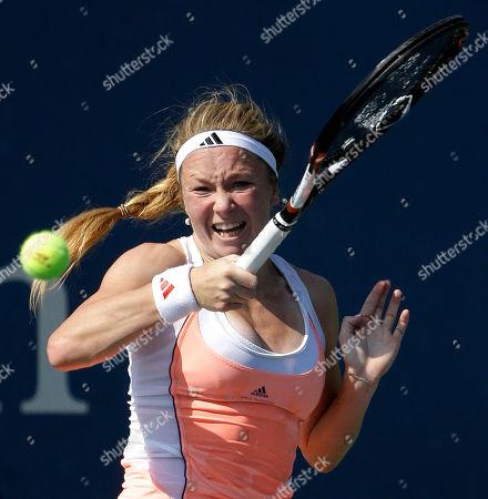 Julia Glushko Julia Glushko of Israel returns a shot against Nadia Petrova of Russia during the first round of the 2013 U.S. Open tennis tournament, in New York
