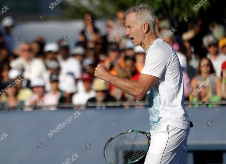 John McEnroe John McEnroe reacts after a point during an exhibition doubles match with his brother, Patrick McEnroe, against Cedric Pioline, of France, and Mats Wilander, of Sweden, at the 2013 U.S. Open tennis tournament, in New York