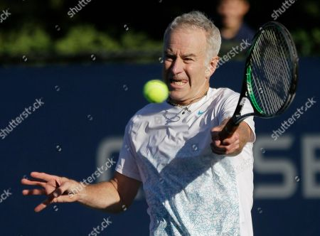 John McEnroe John McEnroe returns a shot during an exhibition doubles match with his brother Patrick McEnroe against Cedric Pioline, of France, and Mats Wilander, of Sweden, at the 2013 U.S. Open tennis tournament, in New York