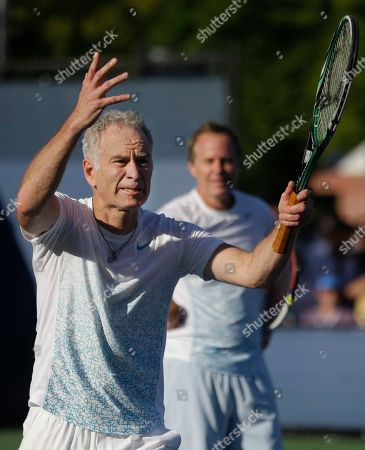 John McEnroe John McEnroe, left, reacts to a call as his brother Patrick McEnroe looks on during an exhibition doubles match against Cedric Pioline, of France, and Mats Wilander, of Sweden, at the 2013 U.S. Open tennis tournament, in New York