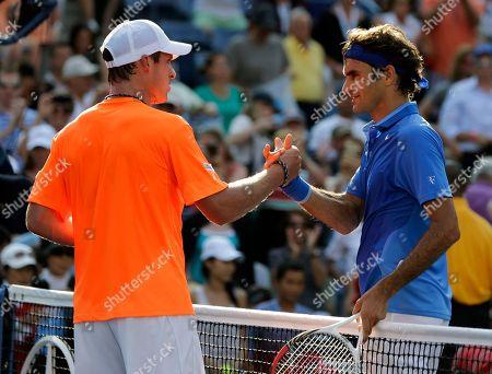 Roger Federer, Grega Zemlja Roger Federer, of Switzerland, greets Grega Zemlja, of Slovenia, after winning their first round match of the 2013 U.S. Open tennis tournament, in New York