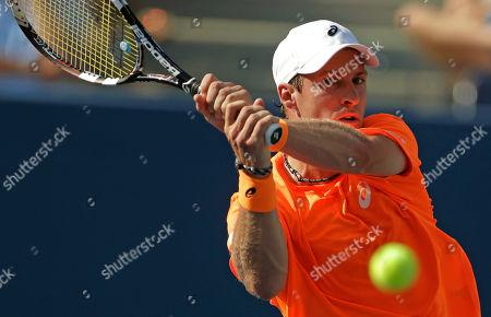 Grega Zemlja Grega Zemlja, of Slovenia, returns a shot against Roger Federer, of Switzerland, during the first round of the 2013 U.S. Open tennis tournament, in New York