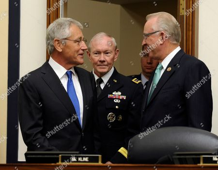 Chuck Hagel, Howard McKeon, Martin Dempsey House Armed Services Committee Chairman Howard McKeon, R-Calif., right, talks with Defense Secretary Chuck Hagel, left, and Joint Chiefs Chairman Gen. Martin Dempsey, on Capitol Hill in Washington, prior to Hagel and Dempsey testifying before the committee's hearing on Syria