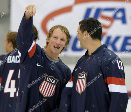 Justin Abdelkader, Bill Guerin Justin Abdelkader, a member of the 2013 USA Hockey Men's National Team and member of NHL's Detroit Red Wings, left, talks with retired hockey player Bill Guerin, right, wearing the newly unveiled team jersey during an event at the Kettler Captials Iceplex in Arlington, Va