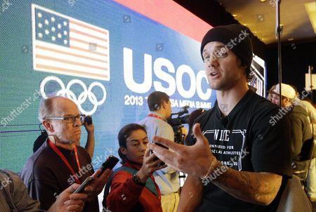 Louie Vito Snowboarder Louie Vito, right, speaks with reporters during a news conference at the at the U.S. Olympic Committee media summit, in Park City, Utah