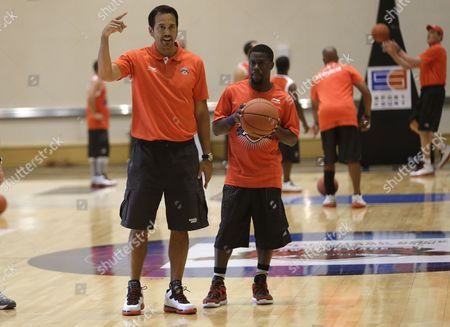 Erik Spoelstra, Kevin Hart Miami Heat head coach Erik Spoelstra, left, and comedian Kevin Hart, right, run drills during the third annual Dwyane Wade Fantasy Basketball Camp, in Hollywood, Fla