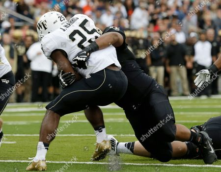 Josh Harris, Richard Glover Wake Forest running back Josh Harris (25) is tackled by Army defensive lineman Richard Glover (98) for a safety during the first half of an NCAA college football game, in West Point, N.Y