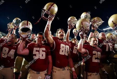 Joel Karim Zoungrana, Michael Fischer, Brian Miller, James McCaffrey Boston College players, including Joel Karim Zoungrana (84), Michael Fischer (56), Brian Miller (80) and James McCaffrey (29), celebrate after defeating Wake Forest 24-10 in an NCAA college football game in Boston