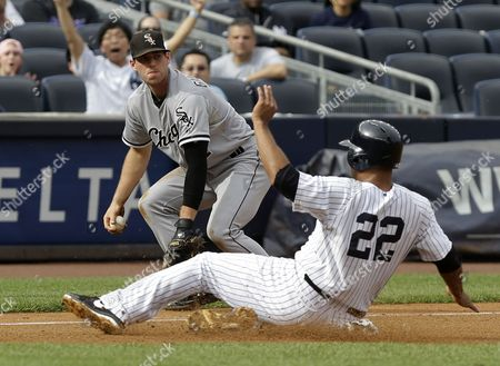 Vernon Wells, Conor Gillaspie New York Yankees' Vernon Wells, bottom, slides safely into third while Chicago White Sox third baseman Conor Gillaspie looks on during the fourth inning of the baseball game at Yankee Stadium in New York