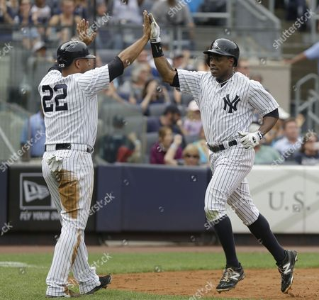 Curtis Granderson, Vernon Wells, Austin Romine New York Yankees' Curtis Granderson, right, celebrates with Vernon Wells after scoring on a single hit by Austin Romine during the fourth inning of the baseball game against the Chicago White Sox at Yankee Stadium in New York