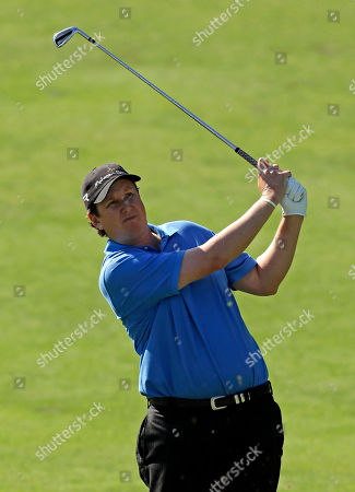 Stock Picture of JJ Henry J.J. Henry hits from the ninth fairway during the first round of the Wyndham Championship golf tournament at the Sedgefield Country Club in Greensboro, N.C