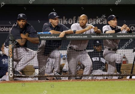 CC Sabathia, Derek Jeter, Vernon Wells, Ichiro Suzuki New York Yankees pitcher CC Sabathia, from left, shortstop Derek Jeter, left fielder Vernon Wells and right fielder Ichiro Suzuki, of Japan, look on from the dugout during a baseball game against the Baltimore Orioles, in Baltimore