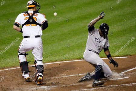 Alfonso Soriano, Matt Wieters New York Yankees' Alfonso Soriano, right, slides into home plate for a run on a single by Vernon Wells as Baltimore Orioles catcher Matt Wieters tries to get hold of the ball in the third inning of a baseball game, in Baltimore