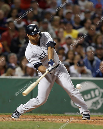 Vernon Wells New York Yankees Vernon Wells swings at a pitch during a baseball game against the Boston Red Sox at Fenway Park, in Boston
