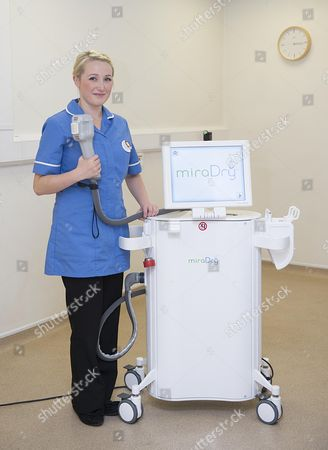Stock Image of Ron Myers And Daughter Zoe Myers (pictured) In Sutton Coldfield West Midlands. They Both Work At Medizen Which Treats People Who Suffer From Sweating. Ron Went To America And Found A Machine Called Miradry Which He Brought Back And Used Successfully On Zoe And Now Is In Use In Their Practice.