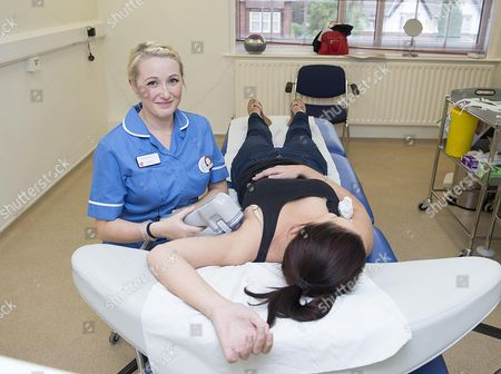 Stock Photo of Ron Myers And Daughter Zoe Myers (pictured) In Sutton Coldfield West Midlands. They Both Work At Medizen Which Treats People Who Suffer From Sweating. Ron Went To America And Found A Machine Called Miradry Which He Brought Back And Used Successfully On Zoe And Now Is In Use In Their Practice.