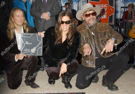 Alex Orbison, son of Roy Orbison, Barbara Orbison (centre) with Hank Williams Jnr (rt) after accepting the Star on the Music City Walk of Fame on behalf of her late husband Roy Orbison