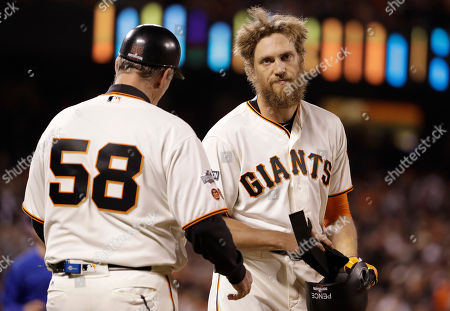 Hunter Pence, Bill Hayes San Francisco Giants' Hunter Pence reacts next to first base coach Bill Hayes (58) after flying out against the Chicago Cubs during the fifth inning of Game 3 of baseball's National League Division Series in San Francisco