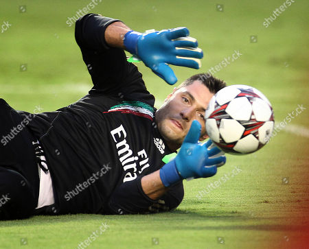 Marco Amelia AC Milan goal keeper Marco Amelia blocks a shot on goal during an evening practice session for the Guinness International Championship Cup at Sun Life Stadium in Miami