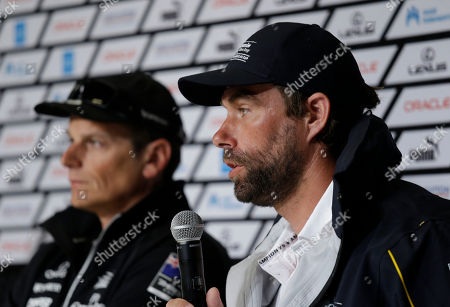 Iain Percy, Dean Barker Iain Percy, right, of Artemis Racing of Sweden, answers questions as Dean Barker, left, of Emirates Team New Zealand listens during a news conference of the America's Cup skippers in San Francisco. The first race in the challenger series is scheduled for Sunday