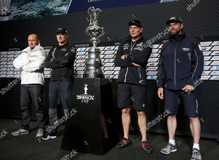 Max Sirena, Dean Barker, Iain Percy, Jimmy Spithill From left, Max Sirena, of Luna Rossa Challenge, from Italy; Jimmy Spithillm of Oracle Team USA; Dean Barker, of Emirates Team New Zealand; and Iain Percy, of Artemis Racing, from Sweden; pose with the America's Cup sailing trophy following a news conference with the skippers, in San Francisco. The first race in the challenger series is scheduled for Sunday