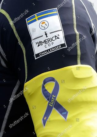 """A tribute to sailor Andrew """"Bart"""" Simpson"""" is worn on the arm skipper Iain Percy of Artemis Racing of Sweden, before their America's Cup challenger series semifinal race against Luna Rossa Challenge, in San Francisco. Luna Rossa Challenge won the race. Simpson was killed on May 9 when the team's boat capsized near Treasure Island during training"""
