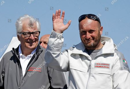 Max Sirena, Patrizio Bertelli Max Sirena, right, skipper of Luna Rossa Challenge, of Italy, waves during a ceremony after the boat's America's Cup challenger series semifinal sailing race, in San Francisco. Luna Rossa Challenge won the race to advance to the challenger finals against Emirates Team New Zealand. At left is team principal Patrizio Bertelli