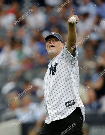 Michael Connelly Crime fiction writer Michael Connelly points to fans before throwing out the ceremonial first pitch in a baseball game between the New York Yankees and the Los Angeles Angels, in New York