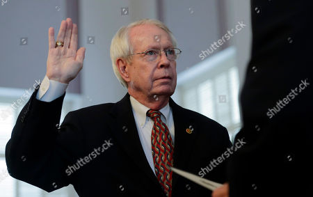Jim Bennett, Robert Bentley Former Secretary of State Jim Bennett is sworn into office by Gov. Robert Bentley at the Alabama Capitol in Montgomery, Ala., . Bennett replaces Secretary of State Beth Chapman who resigned the position effective Wednesday afternoon